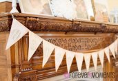 Vintage Inspired Happy Birthday Banner on Fireplace at Landmark Event Center